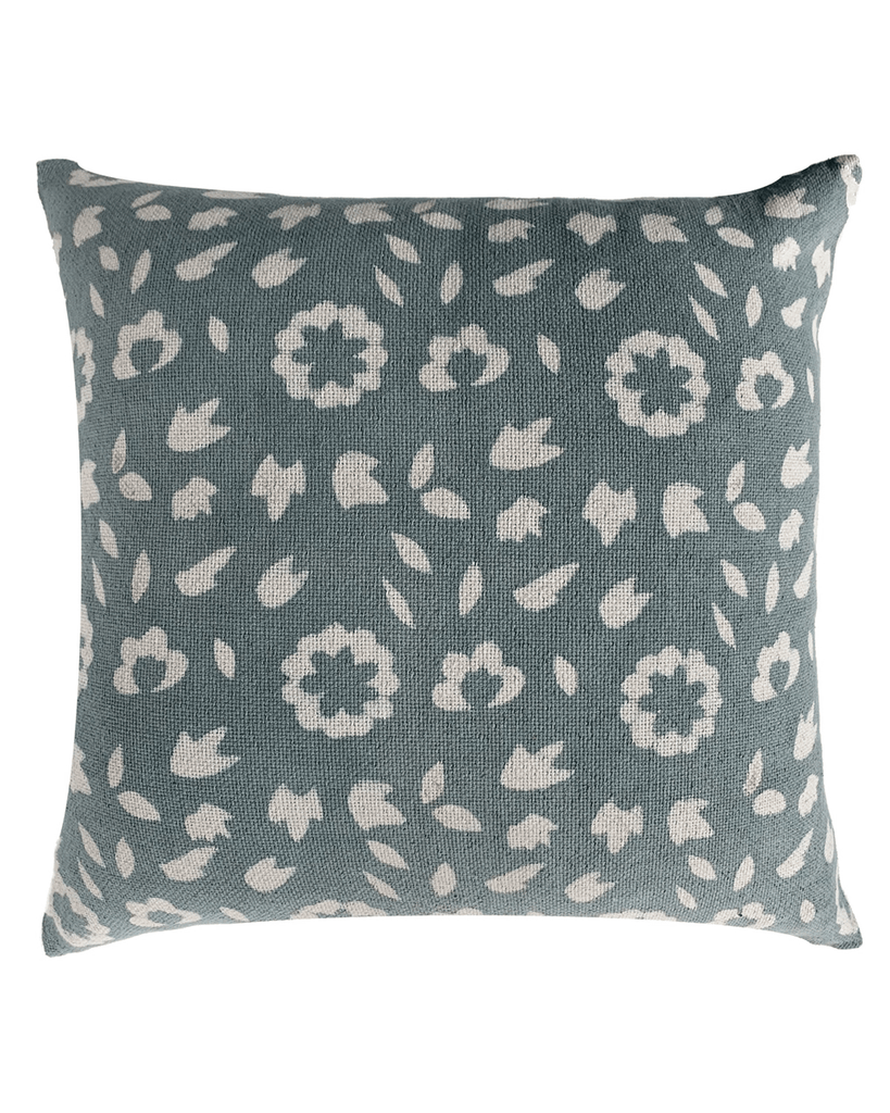 teal floral patterned pillow