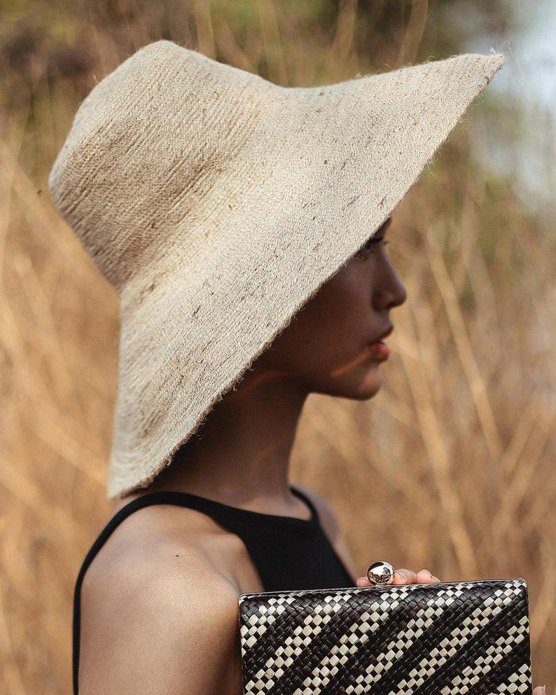 woman wearing jute hat in field