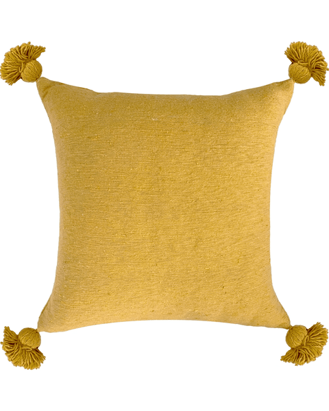 moroccan pom pom pillow in ochre