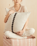 cowrie embroidered pillow in natural