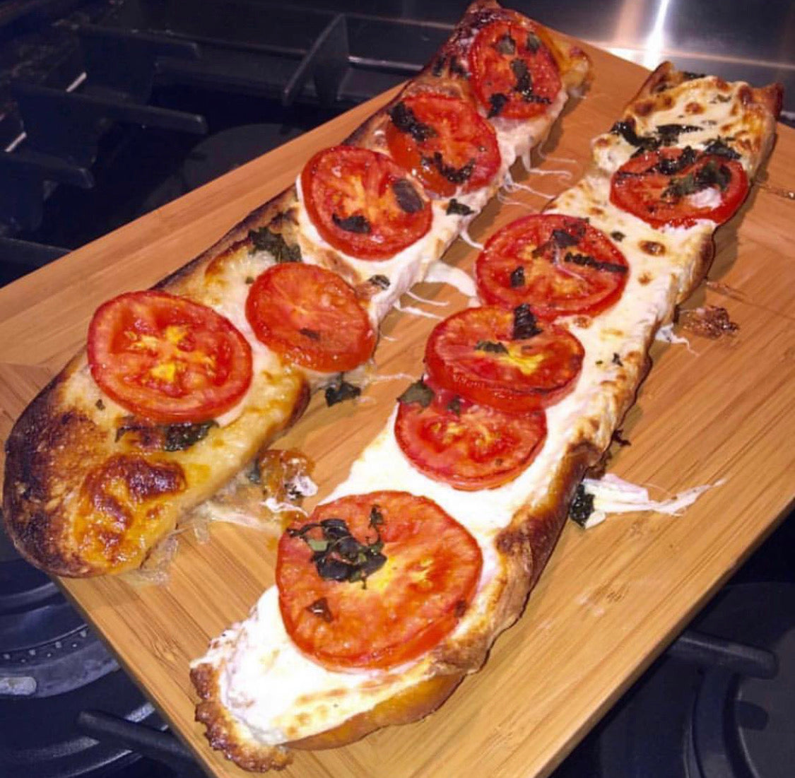 French Bread Pizza with fresh mozzarella tomatoes & JJS OWN Basil Vinaigrette