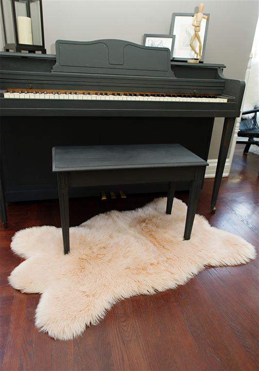 Blush Bear Faux Fur Chair Cover under piano bench