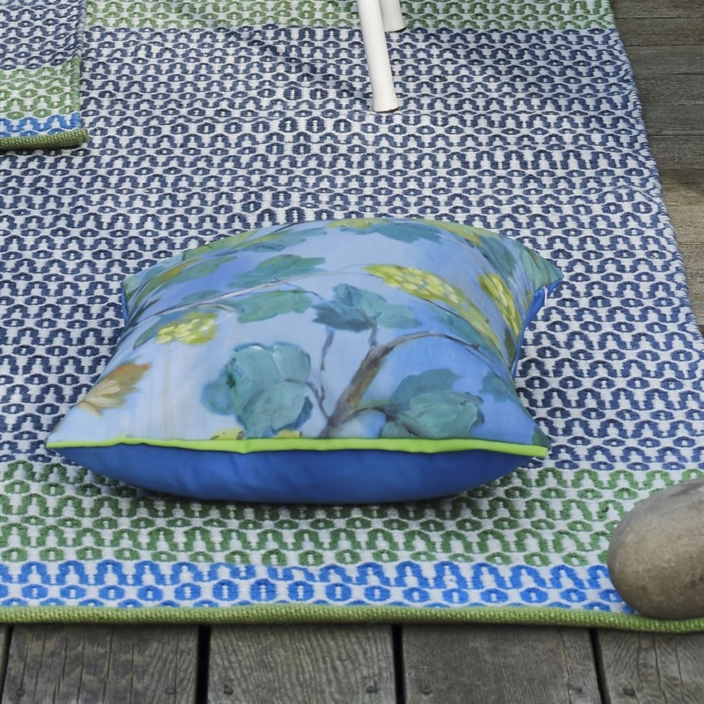 Designers Guild Cortez Cobalt Rug Shown with Outdoor Pillow