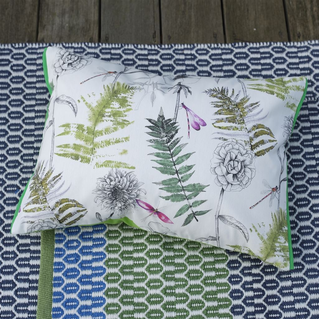 Designers Guild Outdoor Acanthus Moss Decorative Pillow Shown on Floor with outdoor Rug