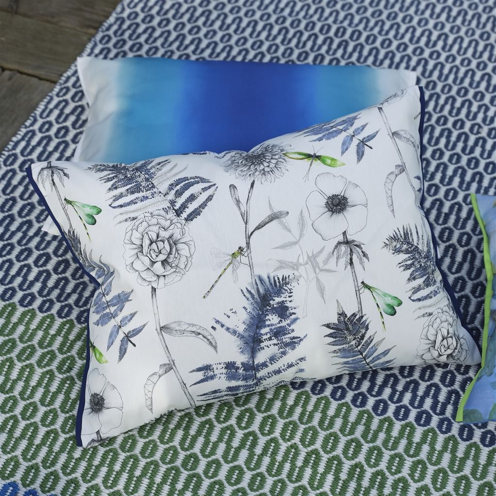 Designers Guild acanthus indigo pillow shown with indoor outdoor pillow