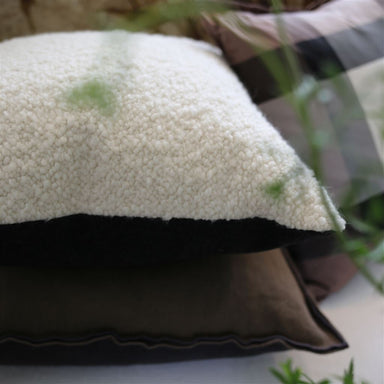 Cormo Chalk Cushion with Other Pillows | Lifestyle Image | Designers Guild at Fig Linens