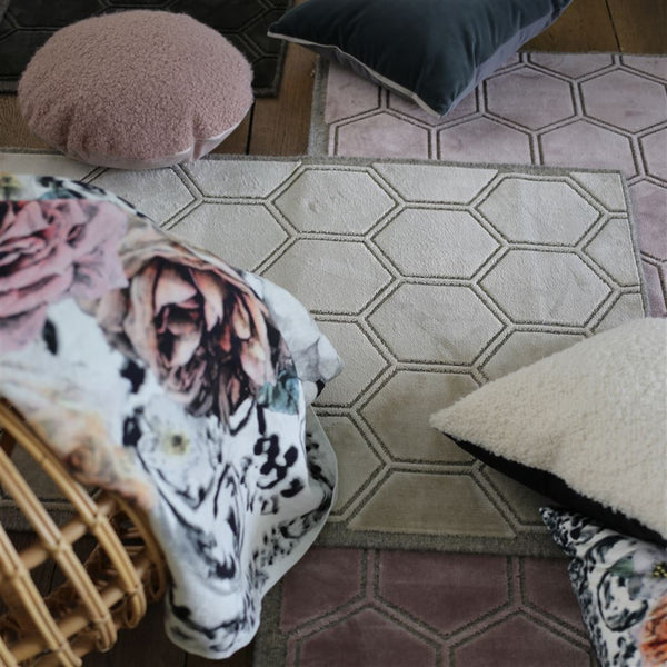 Manipur Natural Rug shown with Floral Pillows | Fig Linens