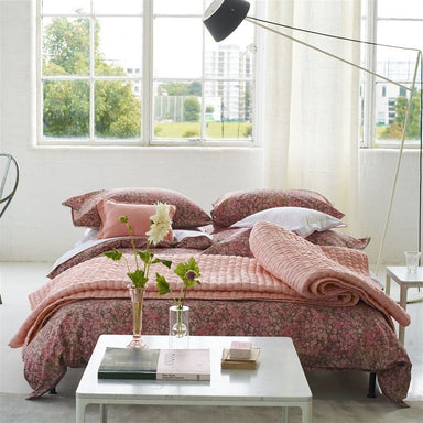 Designers Guild Chenevard Blossom & Peach Quilt in Bedroom with Flowers