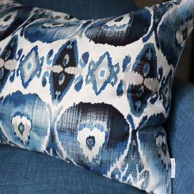 Cuzco Indigo Decorative Pillow shown on Blue Chair