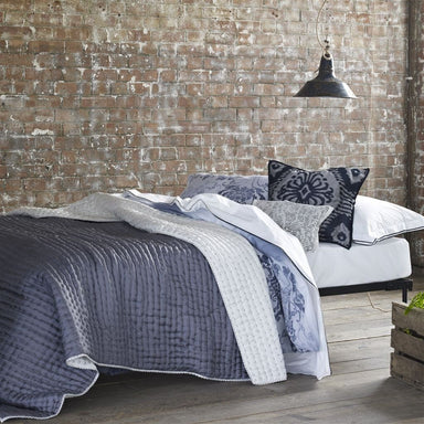 Designers Guild Chenevard Chalk & Graphite Silk Quilt shown on Bed | Fig Linens