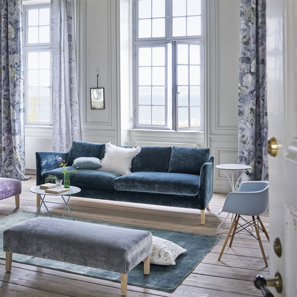 Capisoli Teal Floor Rug- Designers Guild shown with furniture