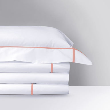 Athena Peche Bedding Collection by Yves Delorme | Fig Linens - White bed linens with peach stitching