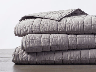 Double-Stitched Quilted Organic Cotton Comforter in Mid-Gray Folded- Coyuchi