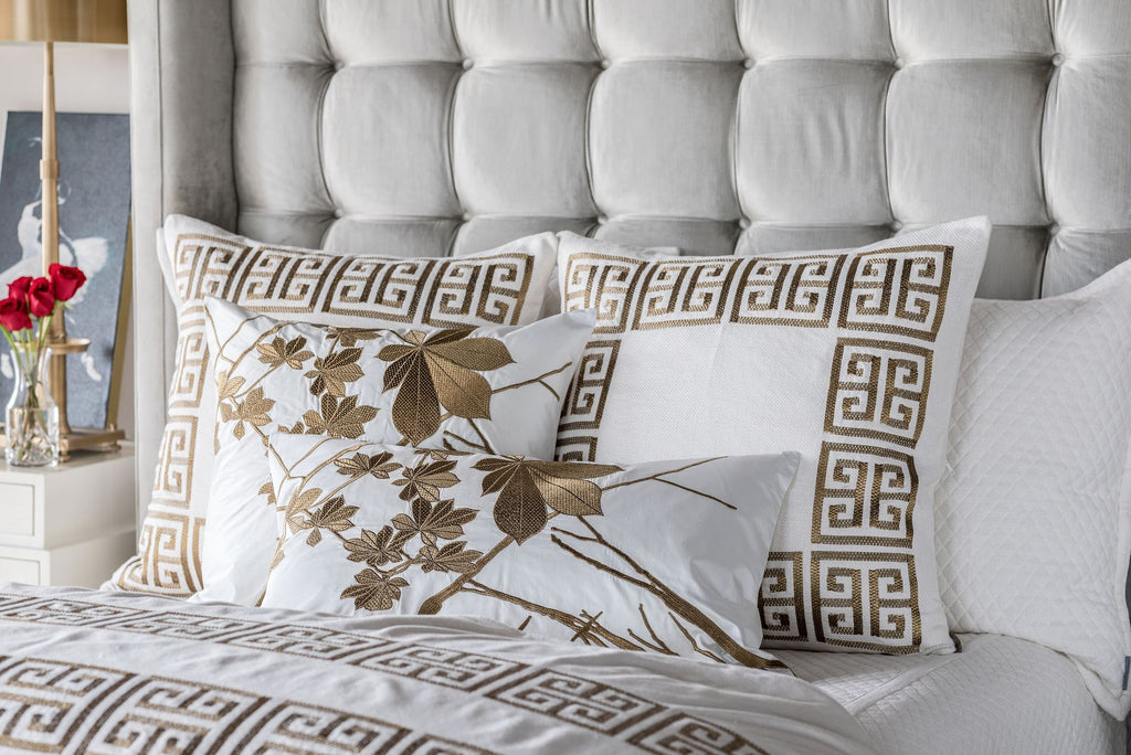 Guy Gold Euro PillowS on bed by Lili Alessandra