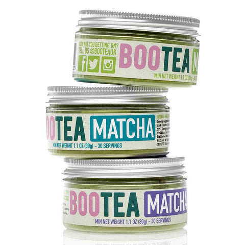 stack of three matcha tea tubs
