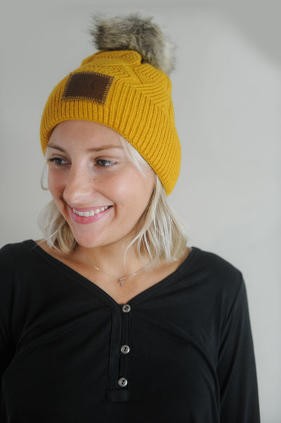 C. C. Cable Knit Pom Beanie
