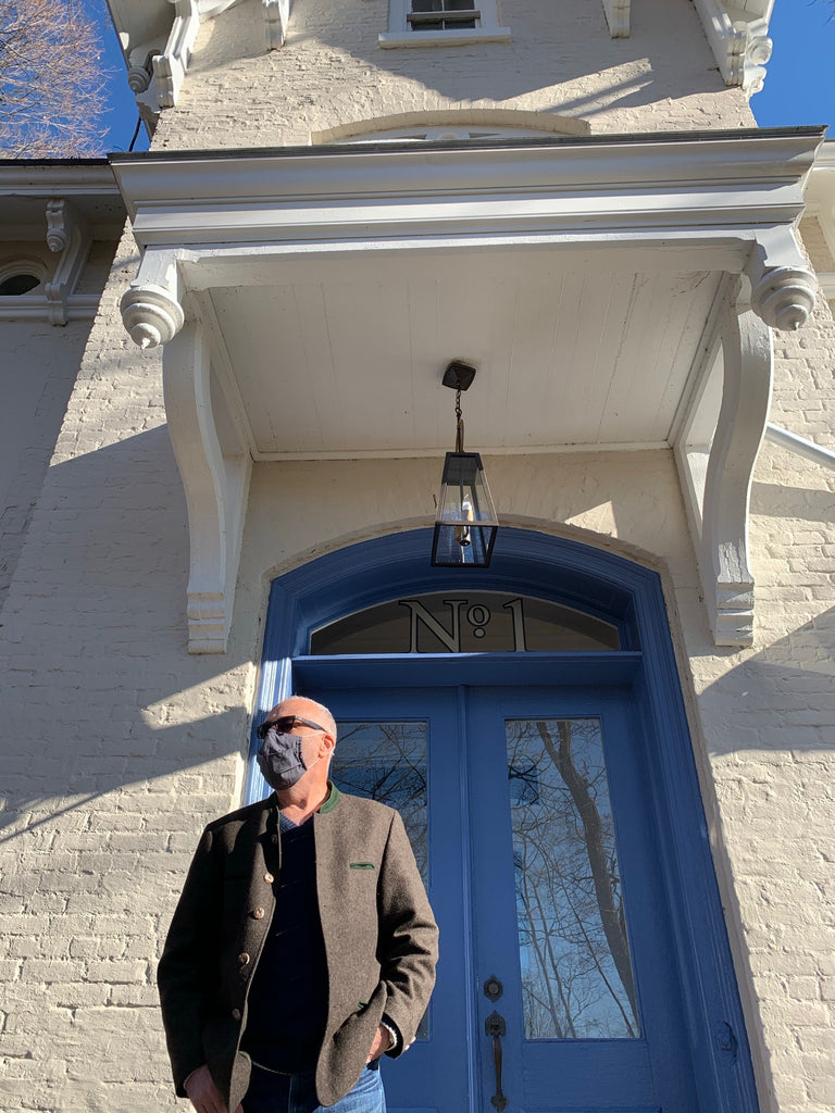 Margaret Ahearn's husband, Smitty, standing near the front entrance of the Kingston Design Showhouse 2020
