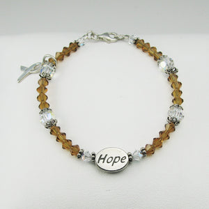 Awareness Support Ribbon Crystal Bracelet, shown with Gold crystals for Childhood Cancer, and Hope message bead