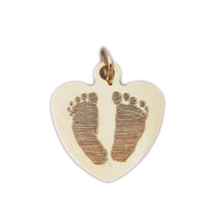 Your baby's, child's, or loved one's actual footprints image custom engraved on a 14K yellow gold small heart charm