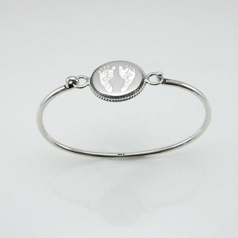Your baby's or child's footprint image custom engraved on a sterling silver round bangle bracelet with rope edge detail