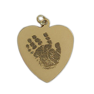 Your baby's, child's, or loved one's actual handprint image custom engraved on a 14K yellow gold large heart pendant
