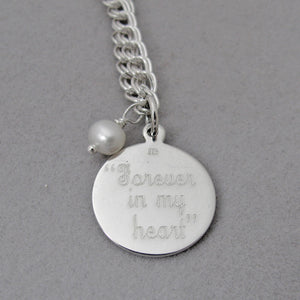"""Forever in my heart"" Sterling Silver Personalized Medium Round Charm in Script Font on charm bracelet with white pearl dangle"