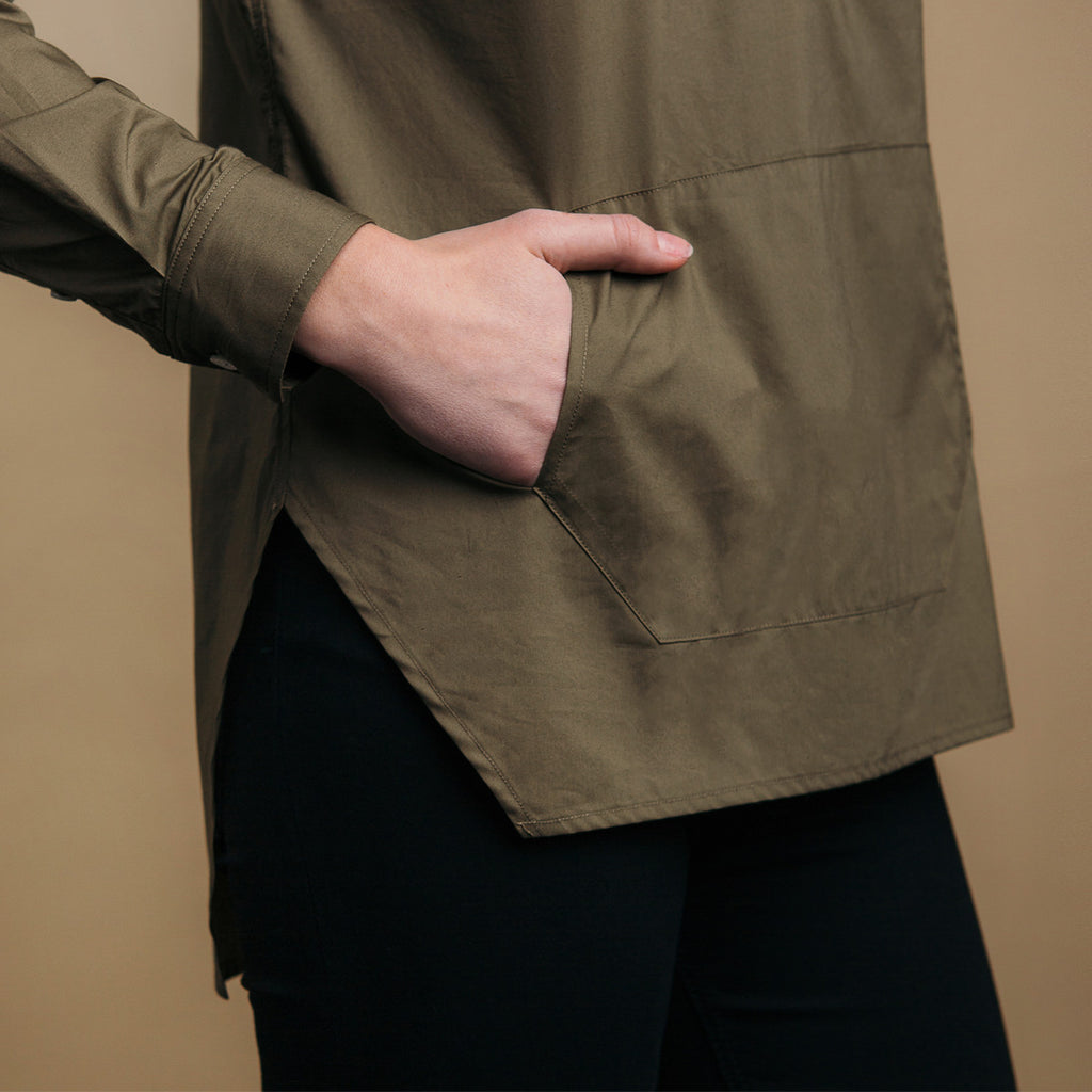 The Trapezoid Pullover - Matte Olive. Side view detail. Straight angled hem.
