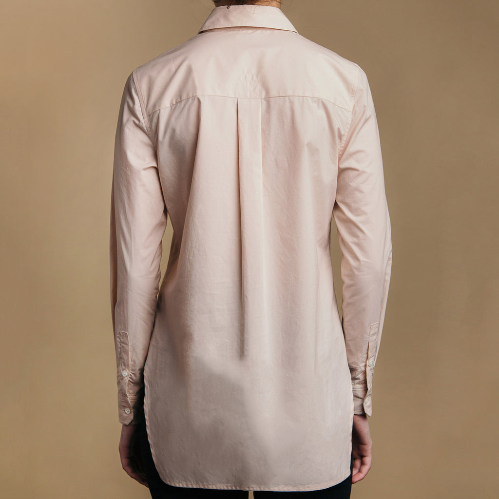 The Trapezoid Pullover - Dusty Blush, back view. Box pleat, real shell cuff buttons.