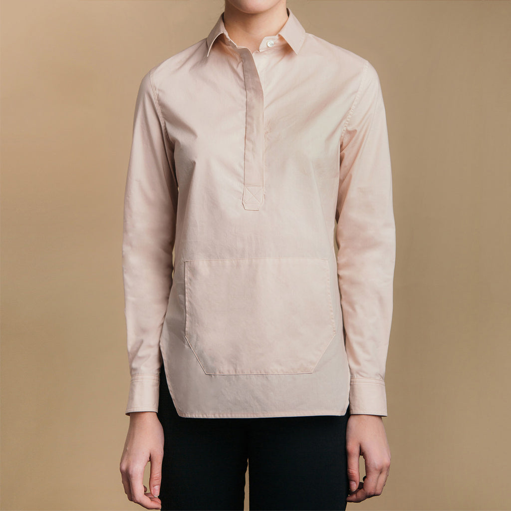 The Trapezoid Pullover - Dusty Blush, front view. Hoodie pocket. Covered placket.