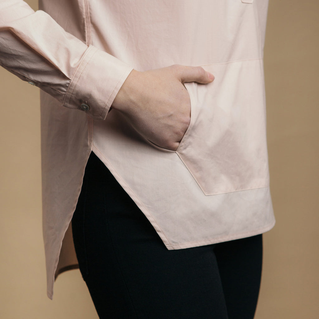The Trapezoid Pullover - Dusty Blush. Side view detail. Straight angled hem.