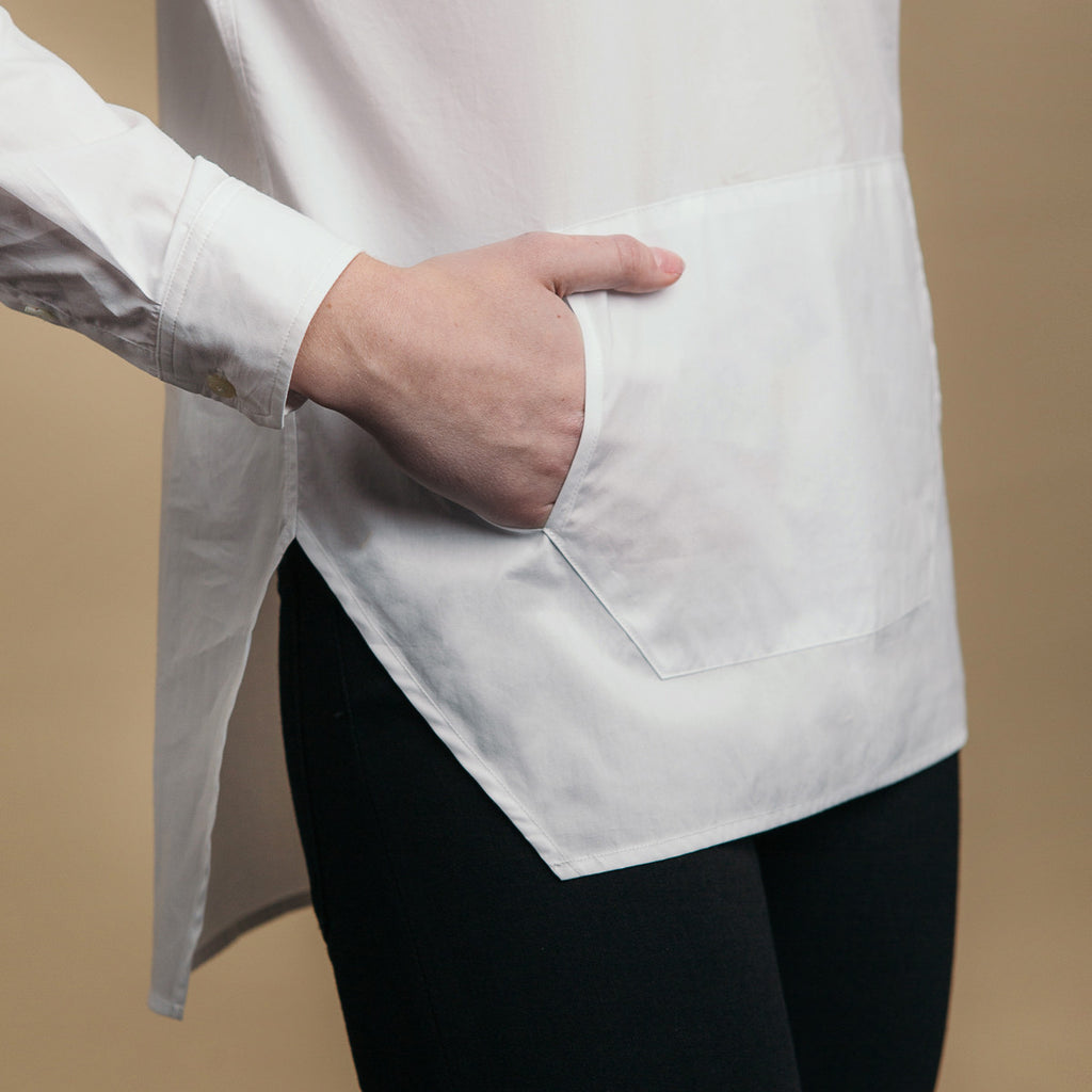 The Trapezoid Pullover - Paper White. Side view detail. Straight angled hem.