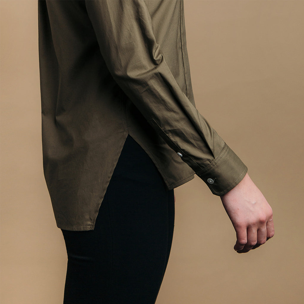 The Trapezoid Shirt - Matte Olive. Side view, angled hem meets at point.