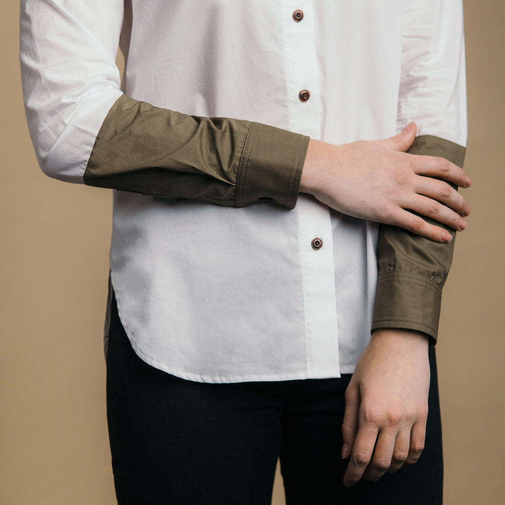 The Hand-Dipped Shirt - Paper White/Matte Olive. Color block arm detail.