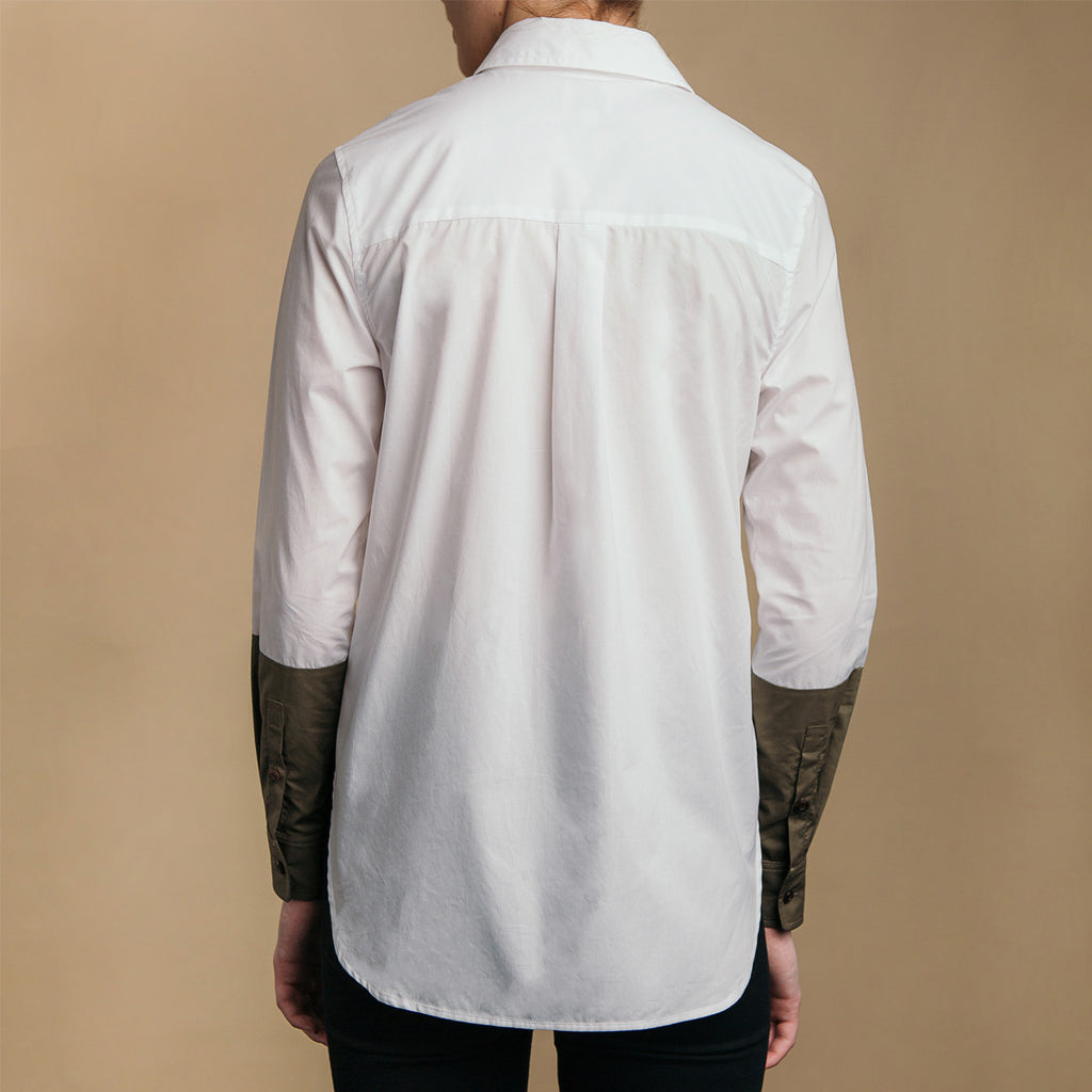 The Hand-Dipped Shirt - Paper White/Matte Olive. Back view. Box pleat, rounded hem.