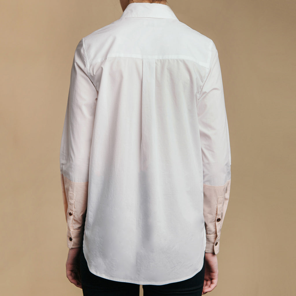 The Hand-Dipped Shirt - Paper White/DustyBlush, back view. Box pleat, cuff placket buttons.