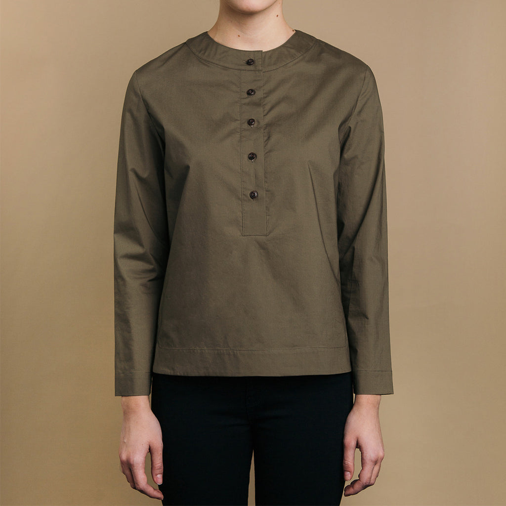 The Equilibrium Shirt - Matte Olive, front view. Half placket. Faux horn buttons.