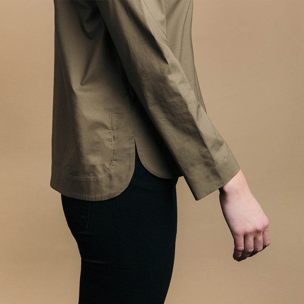 The Equilibrium Shirt - Matte Olive, side view. Rounded side seam hem.