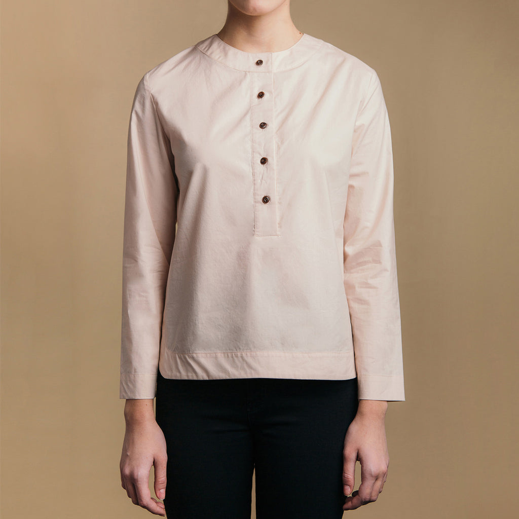 The Equilibrium Shirt - Dusty Blush, front view. Faux horn buttons. Round neck collar.