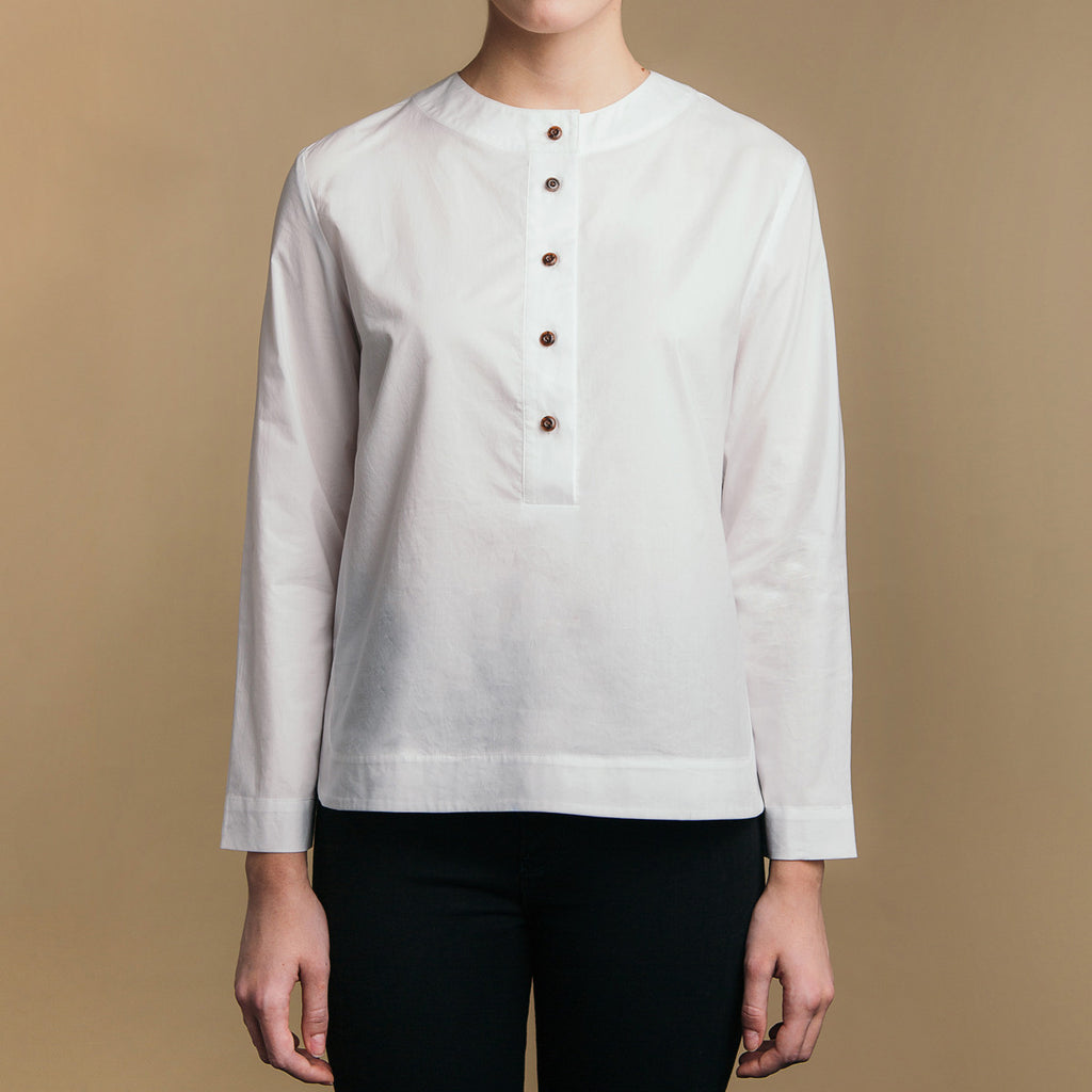 The Equilibrium Shirt - Paper White, front view. Half placket. Faux horn buttons.