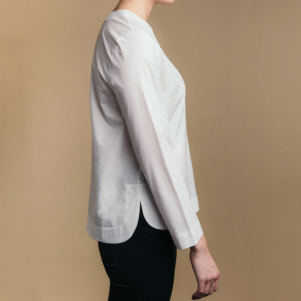 The Equilibrium Shirt - Paper White, side view. Rounded side seams.