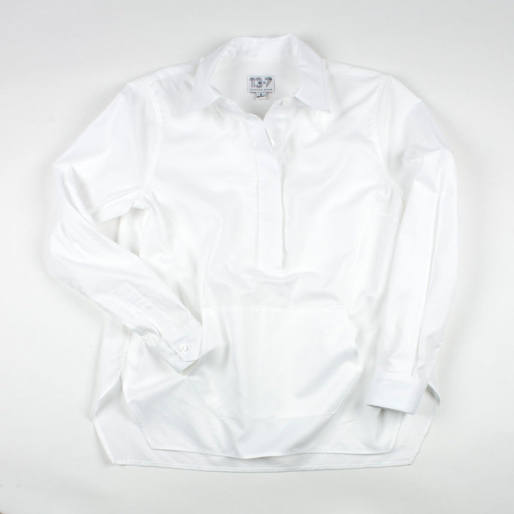 Thirteen Seven white Trapezoid Pullover shirt with front pocket.