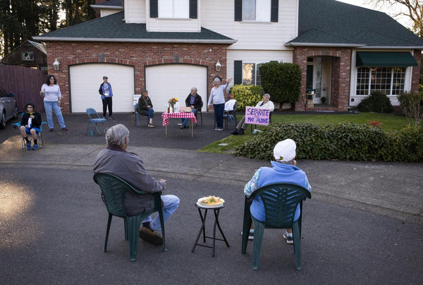 Mary Lou Vignola, center, waves to her neighbors during a socially distant block party she and her husband, Frank, helped organize for their neighborhood off Hawkins Lane in Eugene over the weekend. [Chris Pietsch/The Register-Guard] - registerguard.com