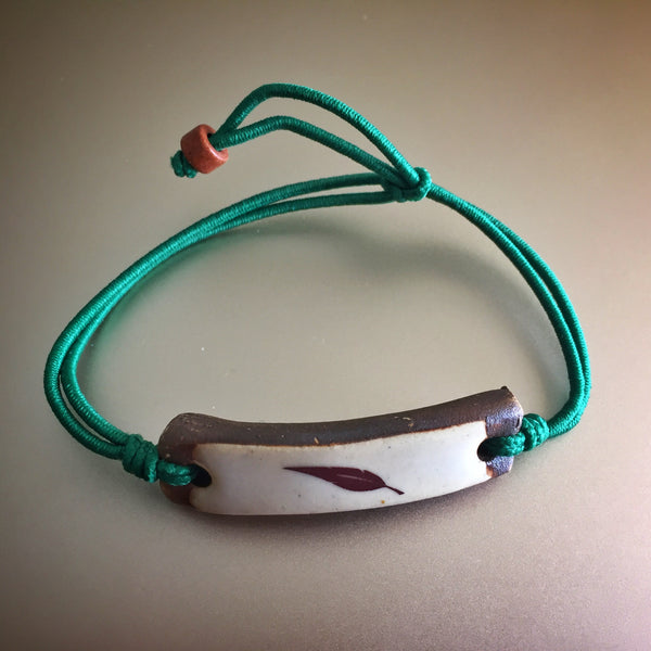 Be Robin Hood Green Feather MudLove Charity Clay Bracelet