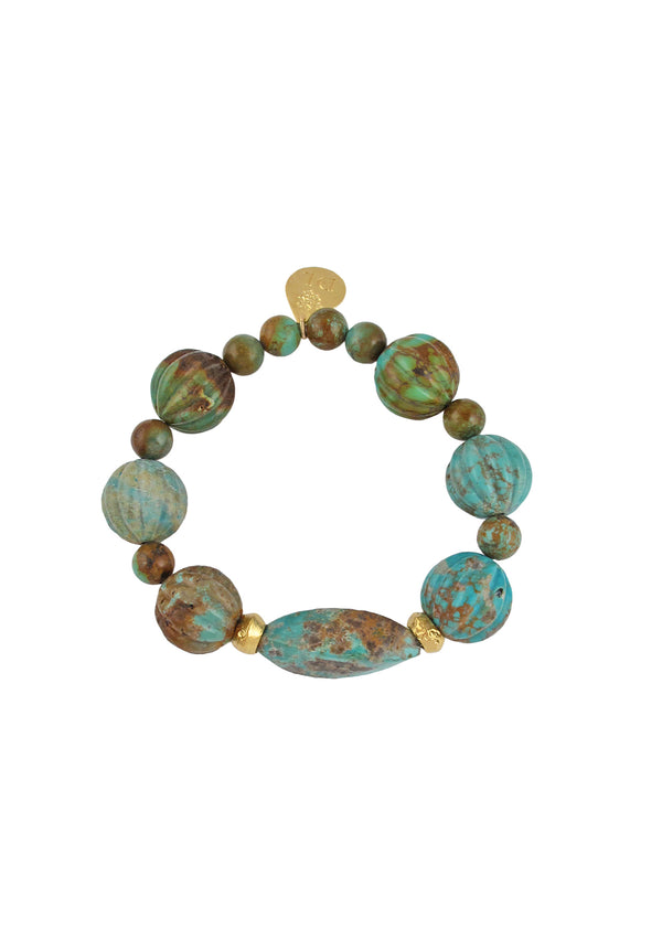 Devon Leigh Hand-carved, genuine turquoise beaded stretch bracelet is elegant and chic, with two 18K gold African bead accents.