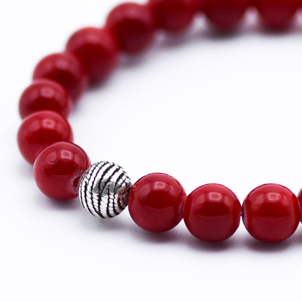 Red coral beads and silver ball bracelet