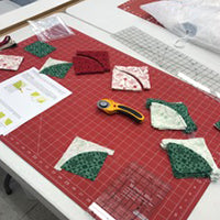 Christmas Tree Table Runner Stack of Fabric