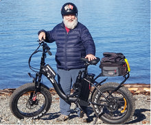 Trail riding with fat tire electric bicycle and rear bike bag and water bottle cage.