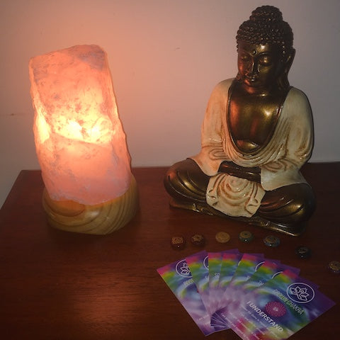 Rose quartz lamp, chakra affirmation cards, buddha