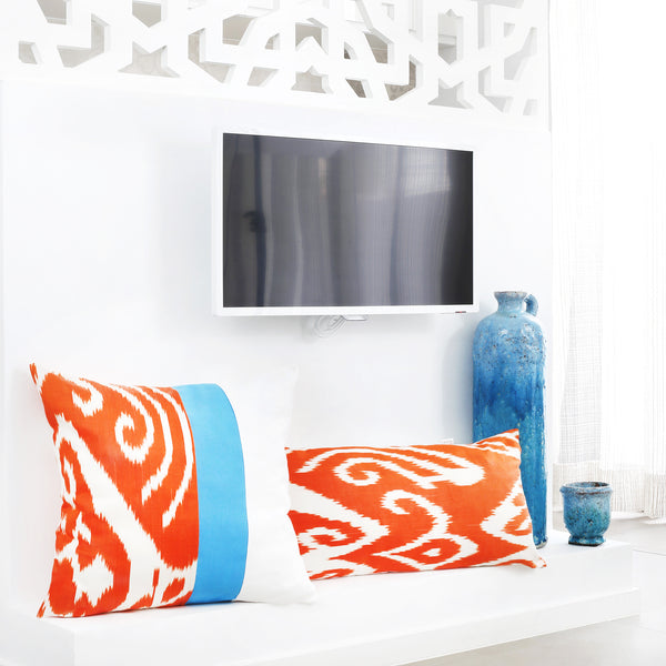 Set of square and rectangular orange ikat cushion covers with white and turquoise contrasting stripes