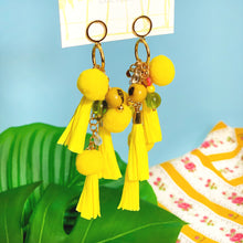 Load image into Gallery viewer, Long summer earrings with yellow paper tassels, colorful glass beads and natural seeds